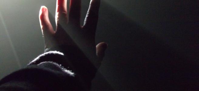 Hand in light beam, photo by Julie Dawn Dennis